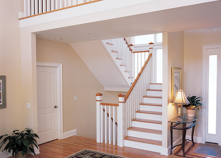 Wood newels for stair systems